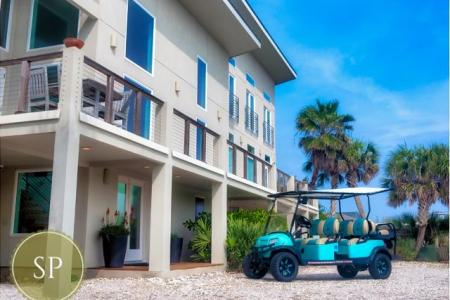 Golf cart in front of a Starkey Property rental