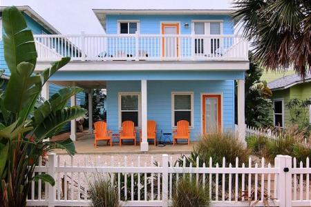Private house rental with a white picket fence