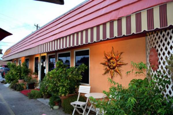 Linda and Maurice Halioua opened The Venetian Hot Plate in Port Aransas, Texas in 1995 after moving to the United States from the area of Venice, Italy. The Venetian Hot Plate offers quality cuisine and a quaint, yet energetic atmosphere, bringing a touch of Italy to this casual island in South Texas.