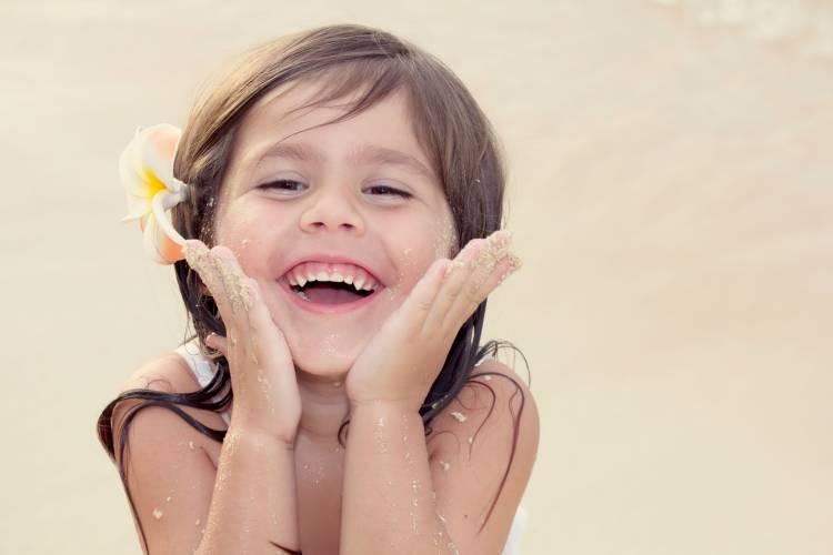 Child enjoying beach