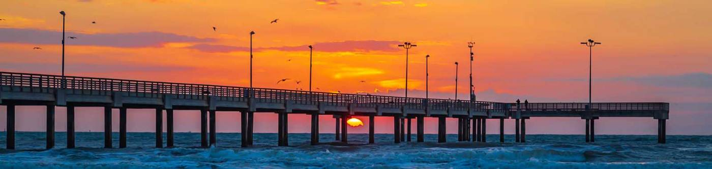 Sunset view of the pier on Port A in Texas